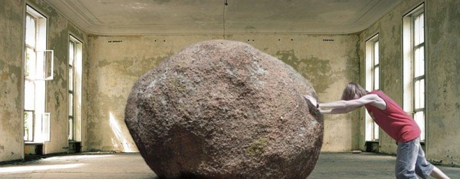 Man Pushing a Boulder